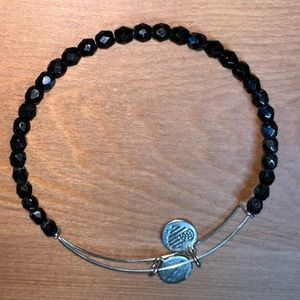 Iridescent dark blue Alex and Ani bracelet